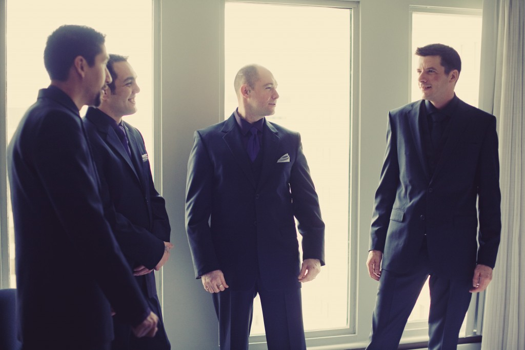 Groomsmen black suits black shirts