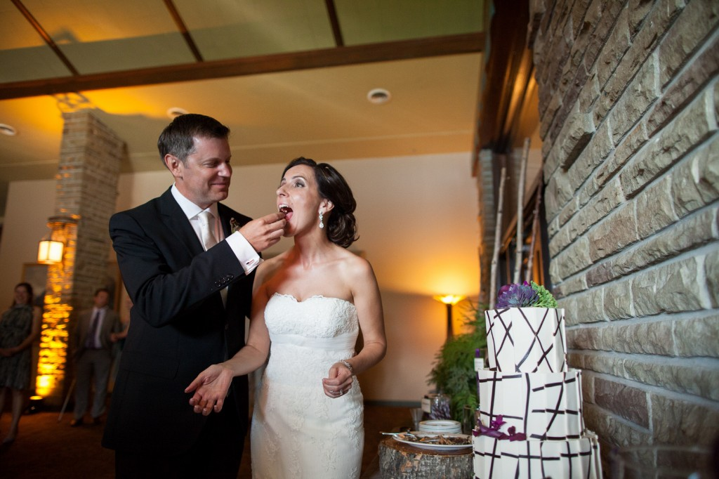 Groom feeds the Bride Some Cake