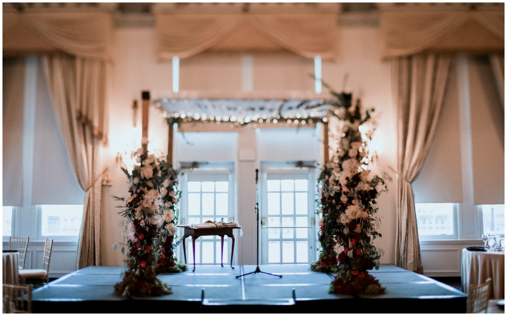 Creative chuppah design flowers greenery